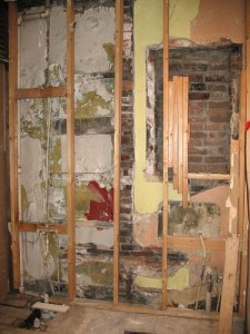 The back wall of my second-floor bath, mid rehab (featuring a curious framing approach for the old medicine cabinet...).