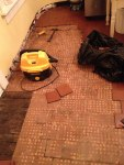 Tile tear-out, then underlayment tear-out. That was a bear.
