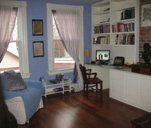 My former study (there are matching shelves on the other side of the brick fireplace bump out...at least there were when I sold it!).